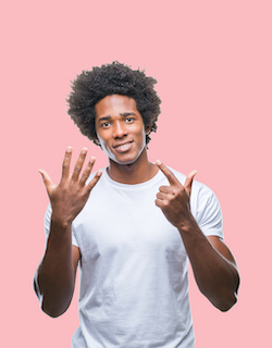 Collage of different ethnics young people wearing white t-shirt over colorful isolated background showing and pointing up with fingers number seven while smiling confident and happy.